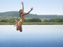Happy girl water jumping Stock Image