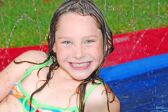 Happy girl in water play royalty free stock photography