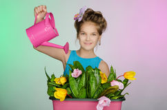 Happy girl watering beautiful flowers Royalty Free Stock Photos