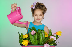Happy girl watering flowers Royalty Free Stock Photo