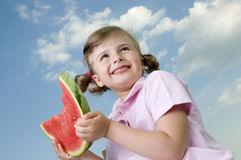 Happy girl with watermelon Royalty Free Stock Photos