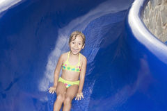 Happy girl  on waterslide Stock Images