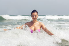 HAPPY GIRL IN WAVES Stock Image