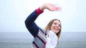Happy girl waving at the sea Stock Photography