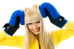 Happy girl wearing boxing gloves Stock Photos