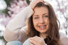 Happy girl wearing braces spring portrait Royalty Free Stock Photos