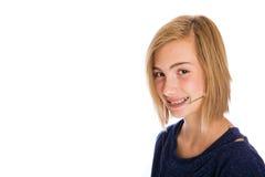 Happy girl wearing dental headgear. A pretty young girl wearing dental headgear Stock Image