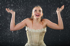 Happy girl wearing in dress smiles in rain Stock Photos