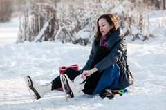 Happy girl wearing ice skates Stock Photos