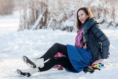 Happy girl wearing ice skates Royalty Free Stock Images