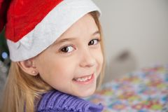 Happy Girl Wearing Santa Hat Royalty Free Stock Image