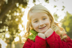 Happy Girl Wearing Winter Coat and Scarf at the Park Royalty Free Stock Image
