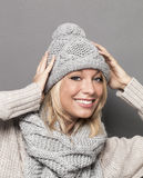 Happy girl wearing wool winter clothing for warmth and comfort Royalty Free Stock Photo