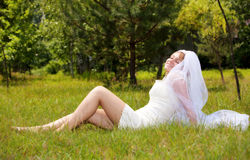 Happy girl in wedding dress Stock Images