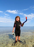 happy girl with wetsuit, masks and snorkels at the s Royalty Free Stock Photos