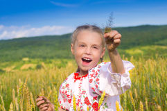 Happy girl on wheat field stock photography