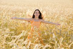 Happy girl on wheat field Royalty Free Stock Photo