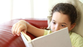 Happy girl with a white book stock footage