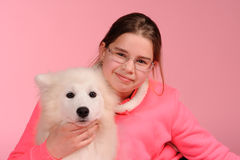 Happy girl with white dog Royalty Free Stock Photography
