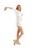 Happy girl in white dress and boots Stock Photo