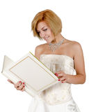 Happy girl in a white evening dress and necklace Royalty Free Stock Photography