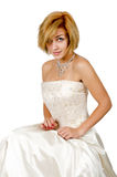 Happy girl in a white evening dress and necklace. Royalty Free Stock Photos
