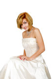 Happy girl in a white evening dress and necklace Royalty Free Stock Photos