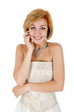 Happy girl in a white evening dress and necklace. Stock Photography