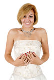 Happy girl in a white evening dress and necklace Royalty Free Stock Photo