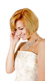 Happy girl in a white evening dress and necklace. Bare shoulders Royalty Free Stock Photography