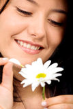 Happy girl with a white flower Stock Photos