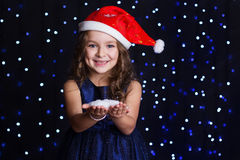 Happy girl with white snowflakes in a studio Royalty Free Stock Images