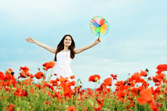 Happy girl with windmill in field Stock Photography