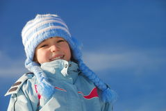 Happy girl in winter clothes Stock Photo