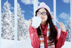 Happy girl in winter clothes enjoy hot drink Royalty Free Stock Image