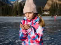 Happy girl in winter clothes enjoying winter holidays stock photo