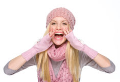 Happy girl in winter clothes shouting Stock Image