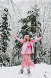 Happy girl in a winter forest Stock Photos