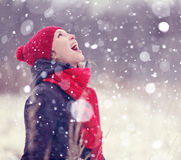 Happy girl in winter forest Royalty Free Stock Photos