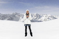 Happy girl with winter hat in the mountains Stock Image