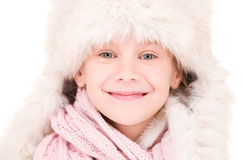 Happy girl in winter hat Stock Images