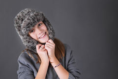Happy girl in winter hat Stock Image