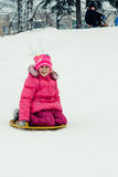 Happy girl in winter outdoors. Royalty Free Stock Images