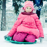 Happy girl in winter outdoors. Stock Photos
