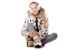Happy girl in winter outfit Stock Photos