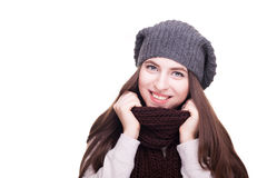 Happy girl in winter scarf smiling at camera Stock Photo