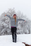 Happy Girl in Winter Snowstorm Stock Photos