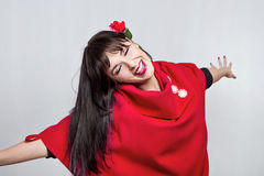 Happy girl. Happy woman in red with a flower in her hair Royalty Free Stock Photo