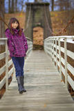 Happy girl on wooden bridge Stock Photos