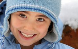 Happy girl in wool hat Stock Photography